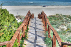 Wooden stairs to the beach Stock Photos