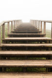 Wooden stairs to the fog Royalty Free Stock Photos