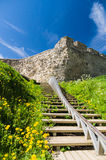 Wooden stairs to the medieval wall Stock Photo