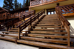 Wooden stairs to the street. Terrace. Entrance  the house. A wide wooden staircase at the entrance to the house. Large terrace Royalty Free Stock Photo