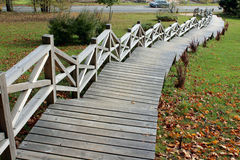 Wooden stairs. Up the hill in autumn stock photo