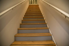 Wooden stairs white walls low angle Stock Photos
