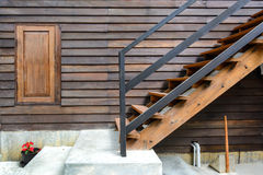 Wooden stairs with wooden window Stock Photography