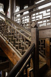 Wooden stairway with latticed banister in aged tower Stock Photos