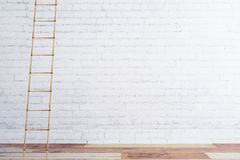 Wooden stairway on white brick wall and wooden floor Stock Image
