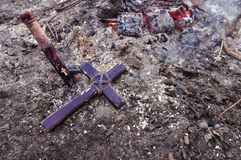 Wooden stake and cross lying on the ashes Royalty Free Stock Photos