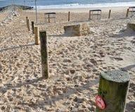 Wooden stakes on beach Stock Photos