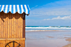 Wooden stall with awning over sea and sky. Background Royalty Free Stock Image