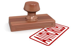 Wooden stamp authorized with red text Stock Photos