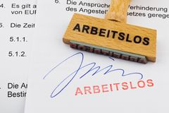 Wooden stamp on the document: unemployed Stock Photo