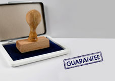 Wooden stamp GUARANTEE royalty free stock photo
