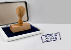 Wooden stamp MADE IN CHINA. Wooden stamp on a desk MADE IN CHINA Royalty Free Stock Photos