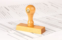 Wooden stamp and papers. On table Royalty Free Stock Photography