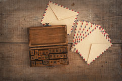 Wooden stamps alphabet and vintage envelopes Stock Photo