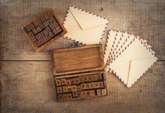 Wooden stamps alphabet and vintage envelopes Stock Photography