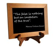 Quote about lie and truth. Wooden stand with quote about lie and truth by Cicero as the concept of counteracting against fake news royalty free stock image