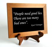 Quote about lie and truth. Wooden stand with quote about lie and truth by Kurt Vonnegut as the concept of counteracting against fake news stock photos