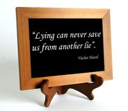 Quote about lie and truth. Wooden stand with quote about lie and truth by Vaclav Havel as the concept of counteracting against fake news royalty free stock image