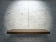 Wooden stand under spot light. With concrete wall for mock up Royalty Free Stock Images