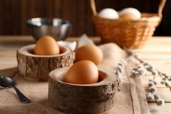 Wooden stands with Ester eggs. On linen tablecloth Royalty Free Stock Image