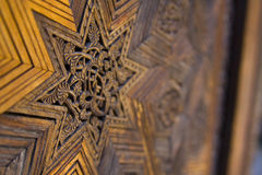 Wooden star. Carving decorative star on wooden floor or wall Stock Images
