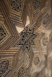 Wooden star. Carving decorative star on wooden floor or wall Royalty Free Stock Photo