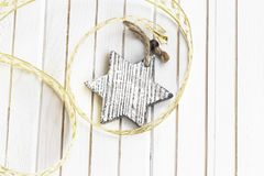 Wooden star Christmas decoration with ribbon on white background Stock Photography
