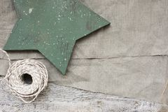 Wooden star and gray textile background. For design Stock Images