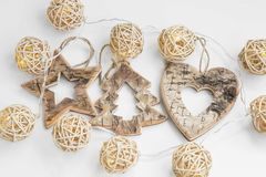 Wooden star, heart and tree ornaments with lights Christmas deco Stock Image