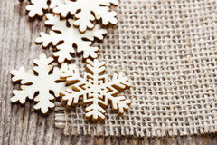 Wooden stars on jute background Royalty Free Stock Photo