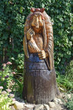 The wooden statue of Baba Yaga in a mortar. Fairy-tale characters Baba Yaga, wooden decoration.  Royalty Free Stock Photography