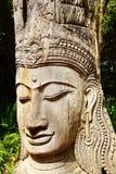 Wooden statue of Buddha. Stock Photo
