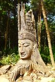 Wooden statue of Buddha. Royalty Free Stock Photography