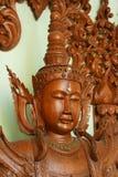 Wooden statue of Buddha stock image