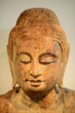 Buddha head. Wooden statue of Buddhas head Royalty Free Stock Images