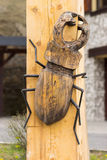 Wooden statue with a bug Stock Image