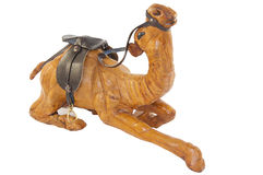 A wooden statue of a camel on a white background Royalty Free Stock Image