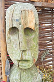 Wooden statue of Celtic period. Reproduction of wooden carving of head of a man holding a spear from Celtic period Royalty Free Stock Photography
