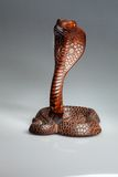 Wooden statue of a cobra, India Stock Photos