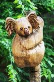 Wooden statue of cute koala, artistic object Stock Image