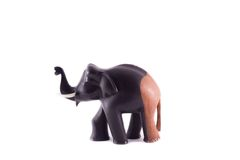 The wooden statue of the elephant black and brown. On a white background royalty free stock photo