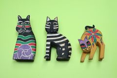 Wooden cat statue,with green background stock image