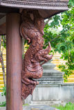 Wooden statue of King of Naga & x28;Serpent King& x29; on wooden poll Stock Photos