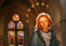 Wooden statue of Mary Stock Photo