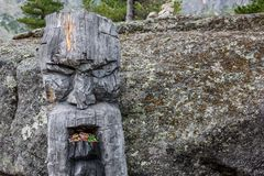 Wooden statue of the Slavic god Perun in the Ergaki national park, Russia royalty free stock photography