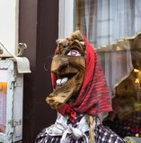 Wooden statue of a traditional witch big nose big chin royalty free stock photography