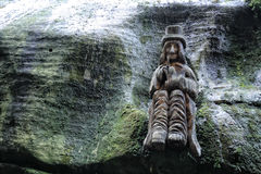 Wooden statue of the water spirit Royalty Free Stock Images