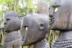 Wooden statues. Closeup of the heads of some old wooden statues Stock Photography