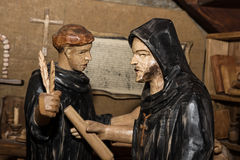 Wooden statues - monks in the monastery Royalty Free Stock Images