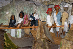 Wooden statues of Tau Tau and coffins in TampangAllo burial cave at Tana Toraja. Indonesia Stock Images